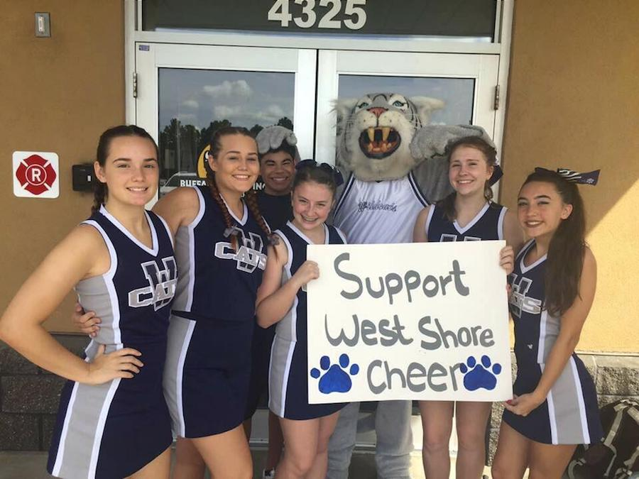 Cheer team raises money for new state-of-the-art outfits
