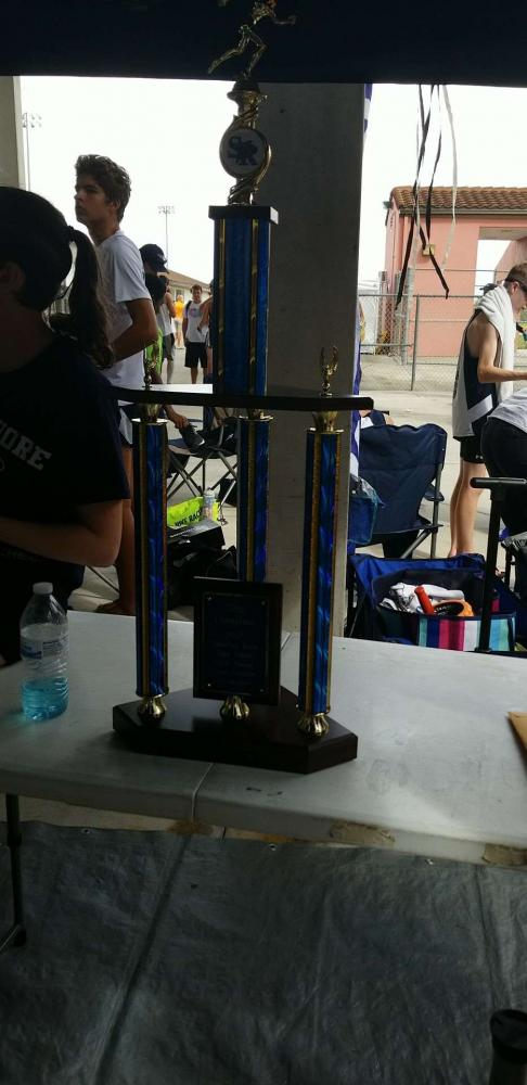The first place trophy given to the girls' cross country team.