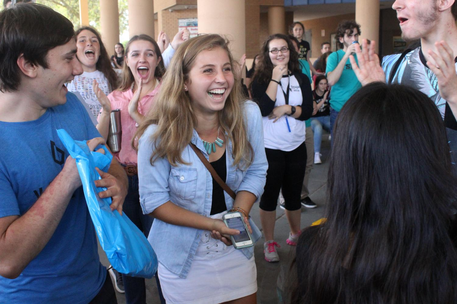 Junior Anna Wilder celebrates her win at the district three FSPA workshop on Oct. 6.