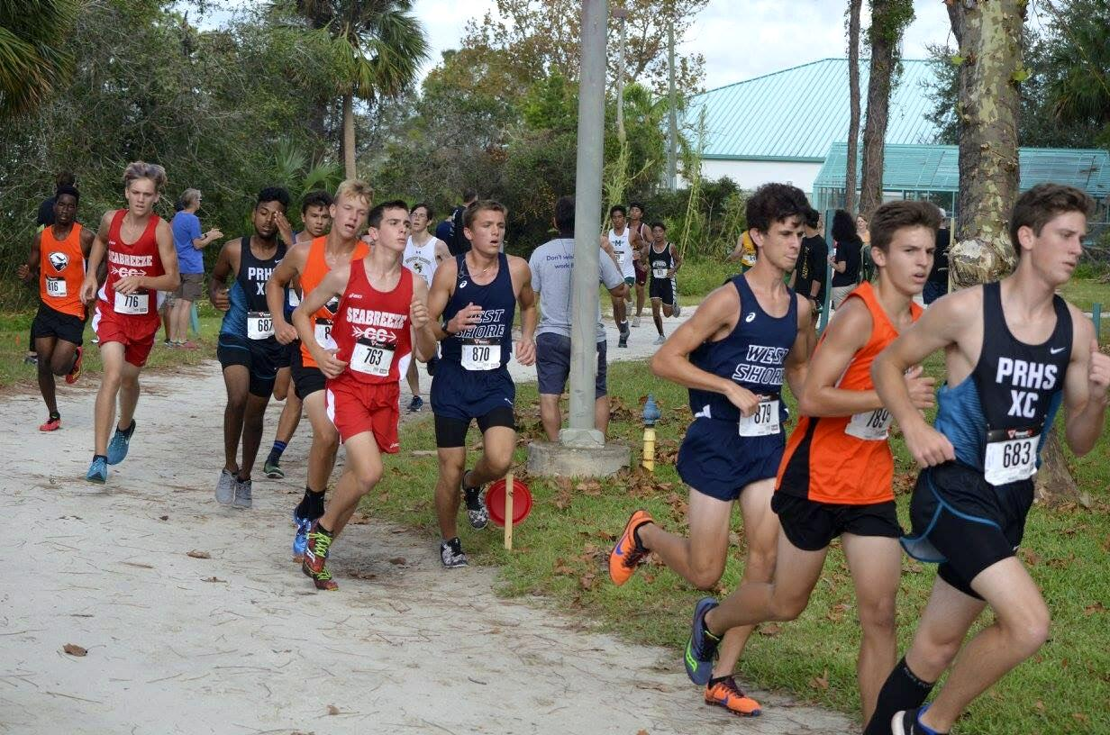 Sophomore Christopher Johnson and senior Adam Blackwell run at the Shark Classic Cross Country Meet.