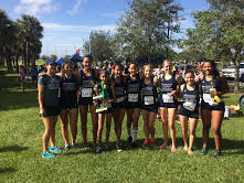 The girls cross country team poses with their trophy won at the Melbourne Invitational on Oct. 7.