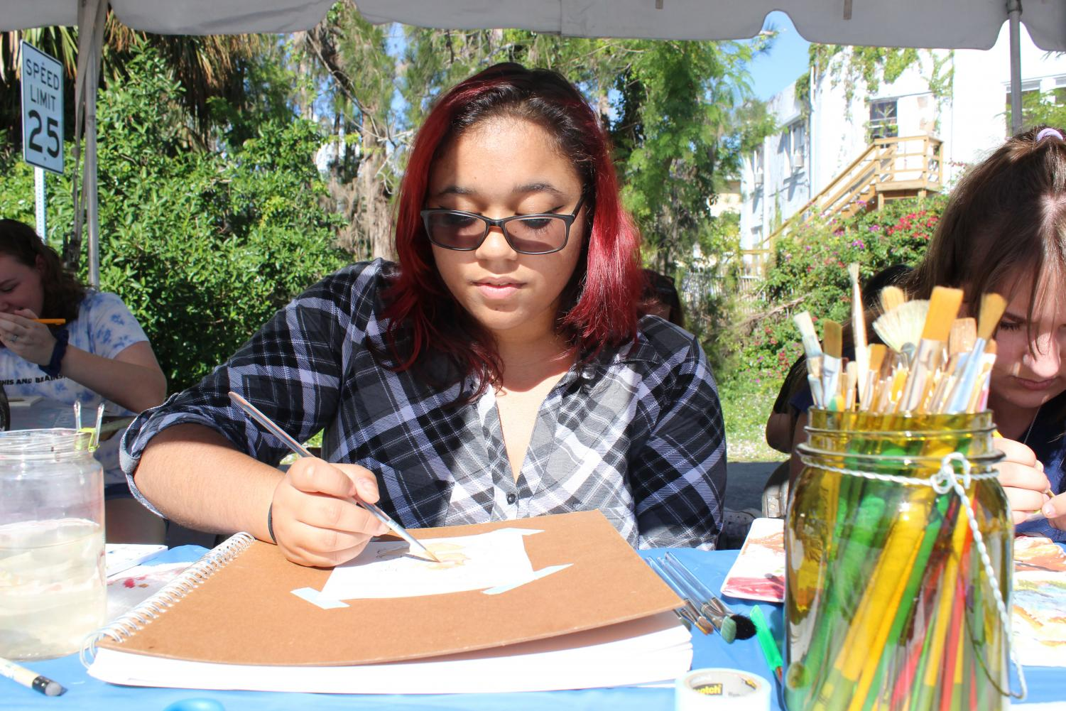 Sophomore Christina Lawson participates in the art festival.