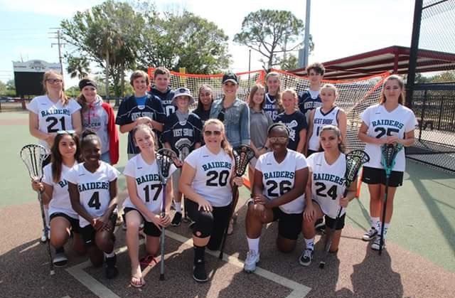 West+Shore+and+Rockledge+lacrosse+players+pose+with+Melissa+Parker%2C+founder+of+the+Parker+Foundation.