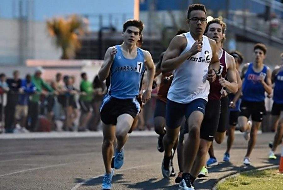 Senior Jared Hayes holds off competition during a recent track meet.