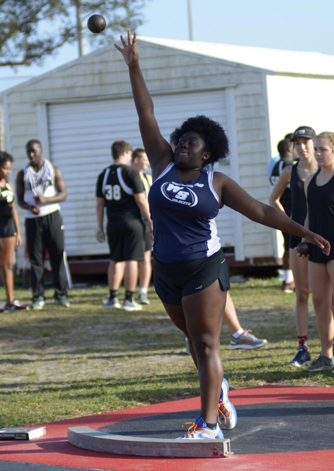 Senior Jadasia Norris throws a shot put at a recent track meet.