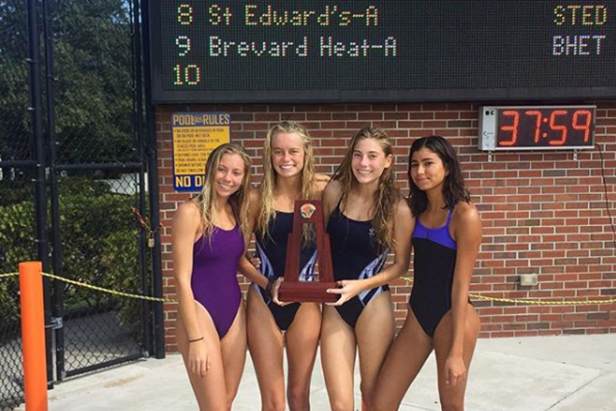 The+girls%27+swim+team+with+their+trophy