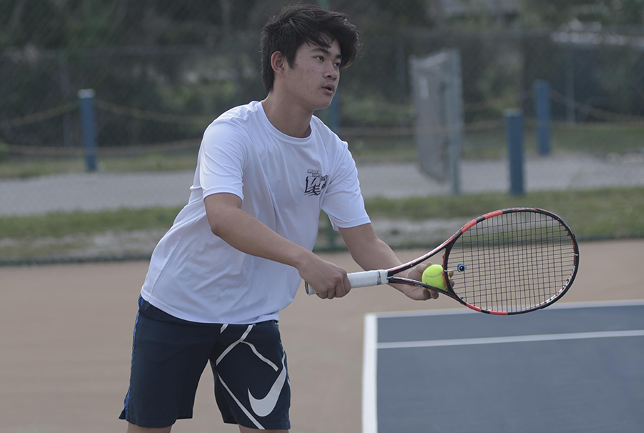 Sophomore Nathan Foo hopes to reclaim his line one position as he prepares to battle challengers during tryouts.