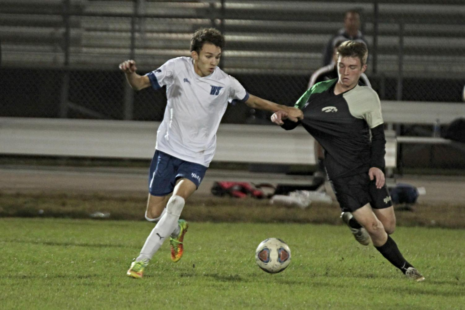 Senior midfielder Cameron Yeutter fights for the ball against a Viera opponent.