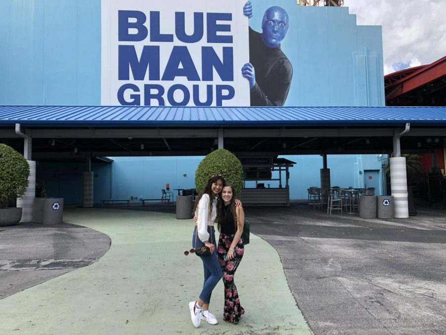 Juniors Jade Norton and Gracie Moravecky stand outside of the entrance to the Blue Man Group show