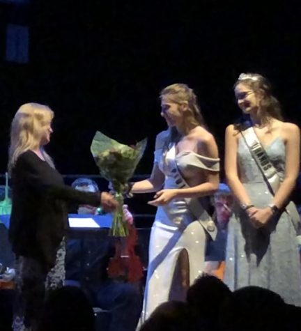 Strings consultant Laura Pinfield receives flowers at a 2019 orchestra concert