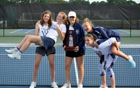 Girls' tennis advances to regional play