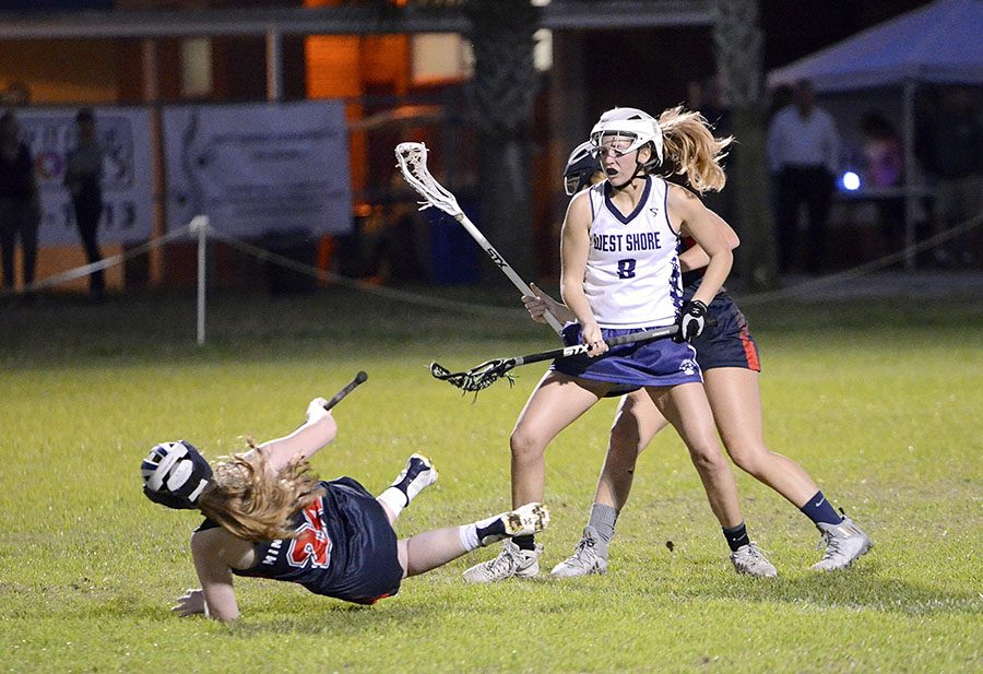 Competing with the defense, junior Isabel Richards shields the ball from Cocoa Beach players.