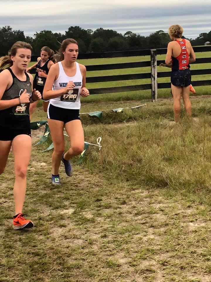 Jonelle Plahuta (12) attempts to overpass another runner.