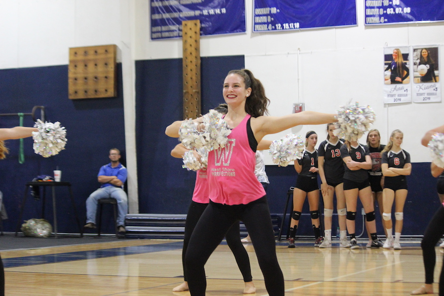 Abi Johnson (12) performs with the Purrfections dance team