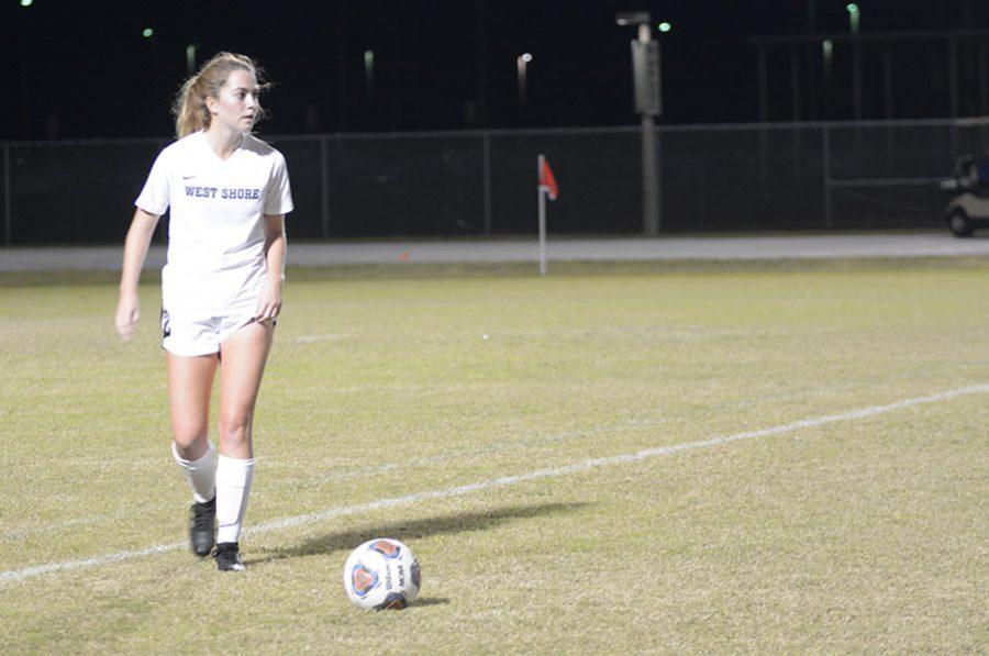 Senior Courtney Carter prepares to pass the ball to a teammate.