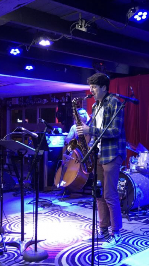 Laith Rukab (11) playing the saxophone at Open Mike's.