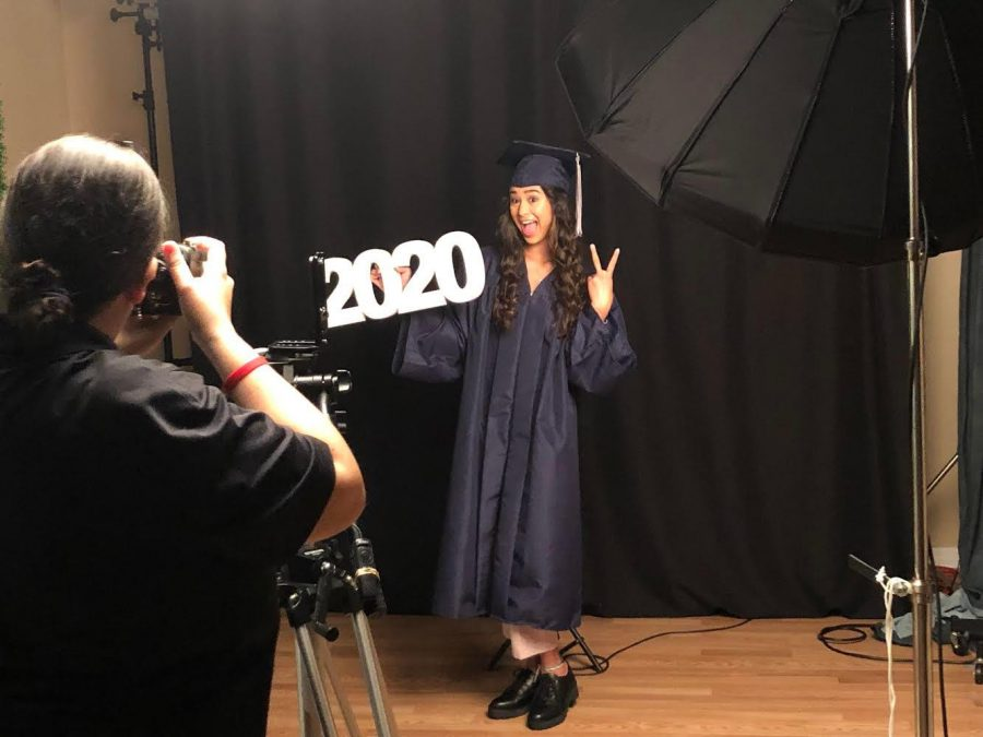 Jade Norton (12) takes senior class photos.
