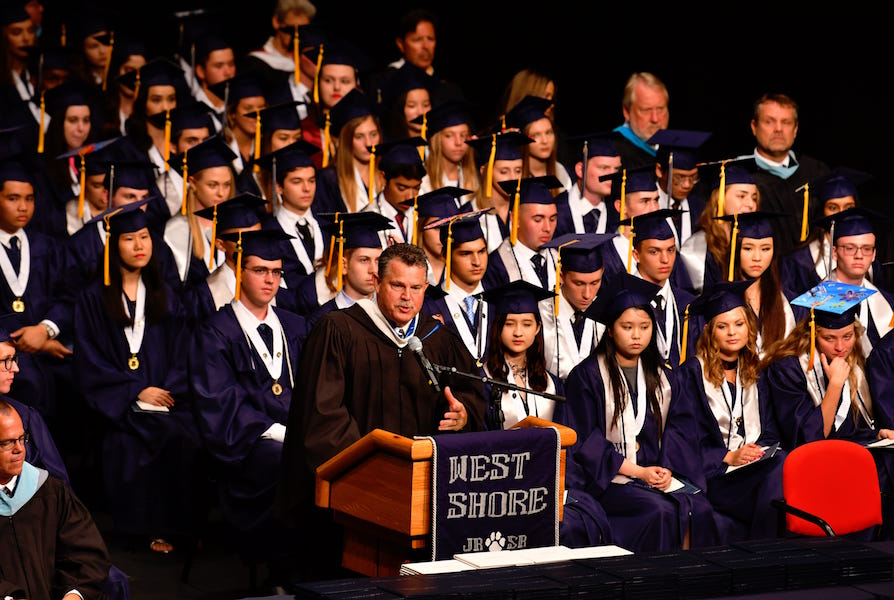Principal Rick Fleming presides over the 2019 graduation ceremony at the King Center.