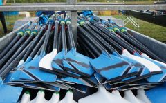 Oars used by Space Coast Crew are laid out on a trailer.