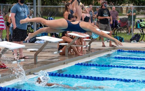 Girls' team captain Layla Auter dives off the block and anchors the 400 free relay.