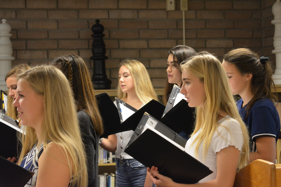 Chorus students perform during a faculty meeting in the media center on Dec. 12, 2019.