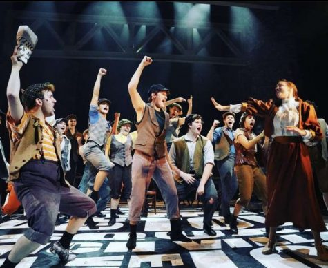 "Thespian Cooper LaMontagne rallies other ""Newsies"" around him during the musical number ""The World Will Know."