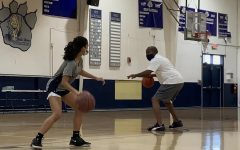 Coach Derrick Hamilton coaches eighth-grader Ashvika Maddikonda during a warm up at the start of afterschool practice on Feb 16.