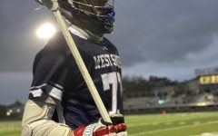 Senior Cris Saladino watches his teammates during the Feb. 19 game at Holy Trinity. The Wildcats lost 14-12.