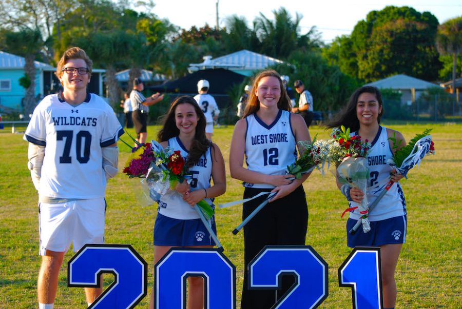 Seniors+Cristopher+Saladino%2C+Sophia+Mandese%2C+Paige+Conrad%2C+and+Bianca+Grande+pose+for+a+photo+after+walking+for+senior+night.