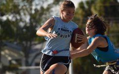 Senior Caitlin Topp eludes 2020 graduate Rosellen Rodriguez during last year's Powderpuff game.