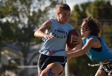 Senior Caitlin Topp eludes 2020 graduate Rosellen Rodriguez during last year's Powderpuff game.