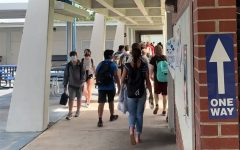 Student change classes in one-way hallways on Monday.