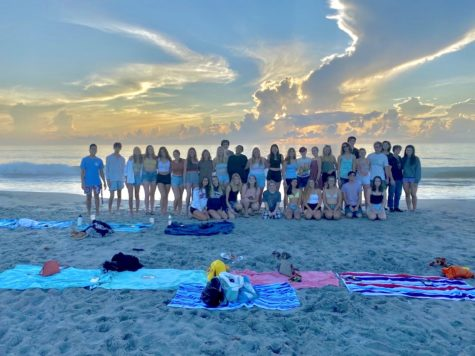 The senior class enjoying the sunrise at 5th Avenue Beach to celebrate the start of the school year.