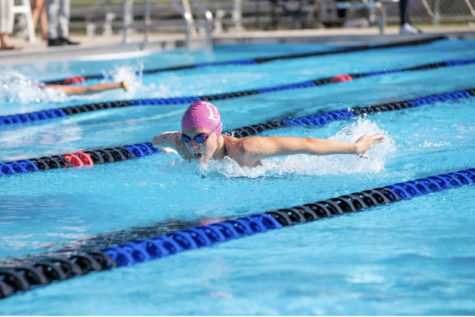 Nicole Riopelle (9) swimming the 100 butterfly